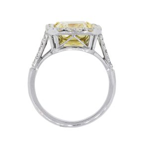 Platinum 18k Gold 5.02ct Fancy Yellow Emerald Cut and 0.74ctw Diamond Halo Ring