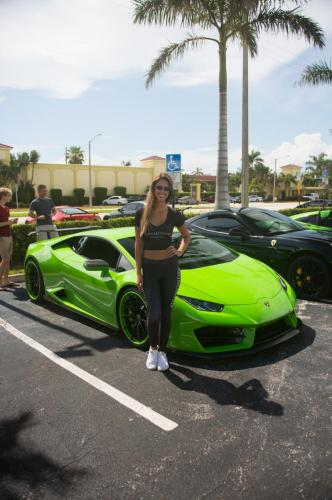 girl and exotic cars